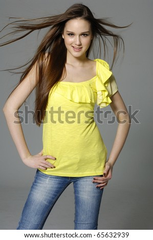 Portrait of pretty model in t-shirt and jeans - stock photo