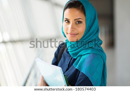 portrait of pretty muslim college student - stock photo