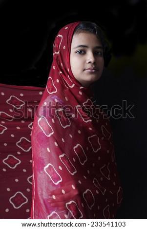 Portrait of pretty Muslim girl - stock photo