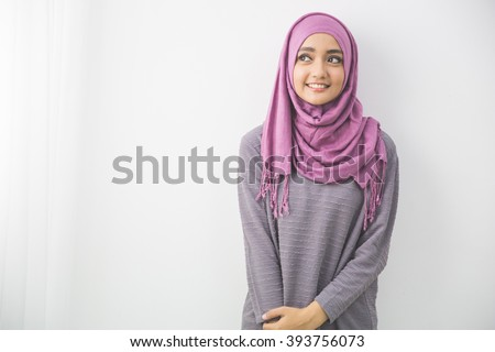 portrait of pretty oung asian muslim woman in head scarf smile - stock photo