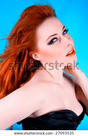 Portrait of pretty redhead woman - stock photo