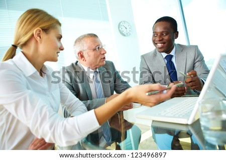 Portrait of pretty secretary, boss and employee discussing their ideas - stock photo