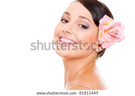 portrait of pretty smiley model with rose in hair. isolated on white background - stock photo