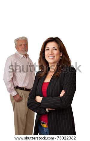 Portrait of pretty smiling businesswoman with out of focus sad looking mature man in background.  Isolated on white. - stock photo