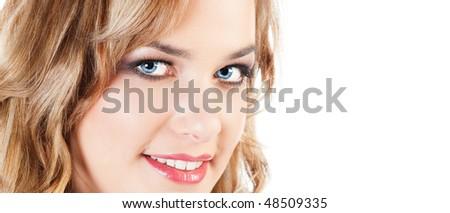 Portrait of pretty smiling young blond woman; isolated on white; copy space - stock photo