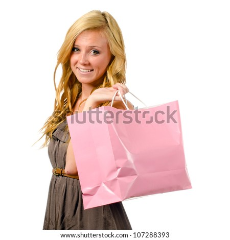 Portrait of pretty teen girl with pink shopping bag isolated on white - stock photo