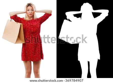 Portrait of pretty woman in red with shopping bag. Clipping mask. - stock photo