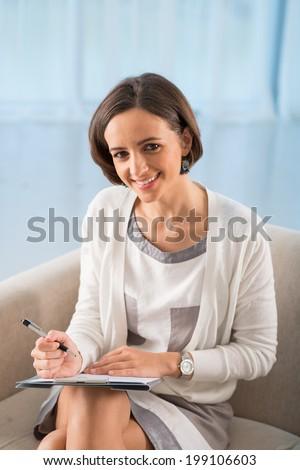 Portrait of pretty woman psychologist - stock photo