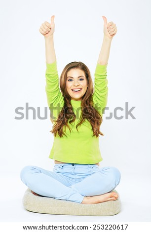 Portrait of pretty woman with hands up. Thumb. Winner style posing. isolated on white. - stock photo