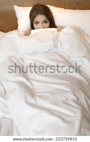 Portrait of pretty young adult attractive sexy and sensuality beautiful brunette woman sleeping in bed on luxury style apartment - stock photo