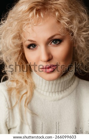 portrait of pretty young beautiful blond woman in white sweater - stock photo