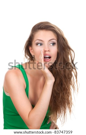 portrait of pretty young beautiful woman whispering or calling out to someone, talking gossip, isolated over white background - stock photo
