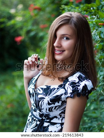Portrait of pretty young girl in a park  - stock photo