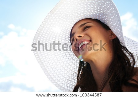 Portrait of pretty young lady in hat - stock photo