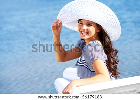Portrait of pretty young lady in hat enjoying summer vacation - stock photo