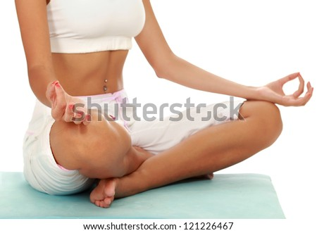 Portrait of pretty young woman doing exercise on mat , isolated on white background - stock photo