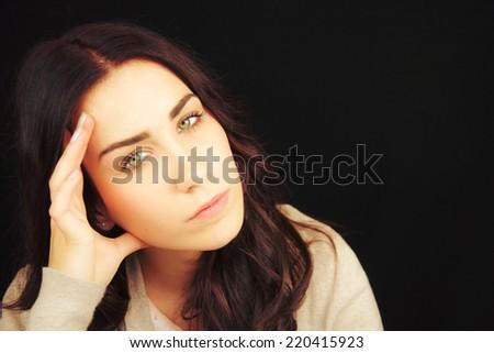 Portrait of pretty young woman having a headache, - stock photo