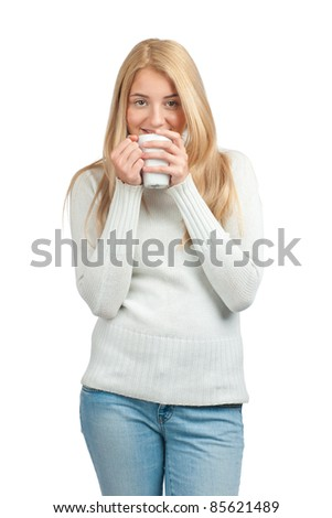 Portrait of pretty young woman in casual wear holding cup of coffee - stock photo