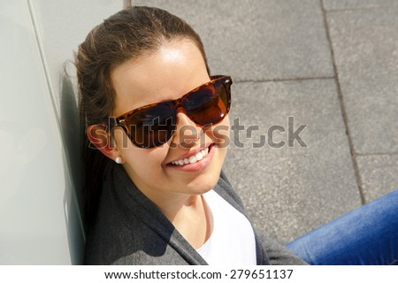 portrait of pretty young woman smiling closeup - stock photo