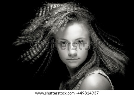 Portrait of pretty young woman with curly hair. Sepia tone. - stock photo