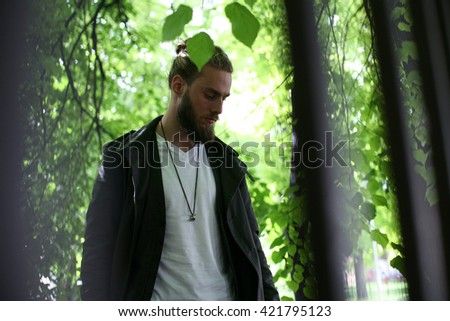 Portrait of prisoner behind the bars outdoor.  - stock photo