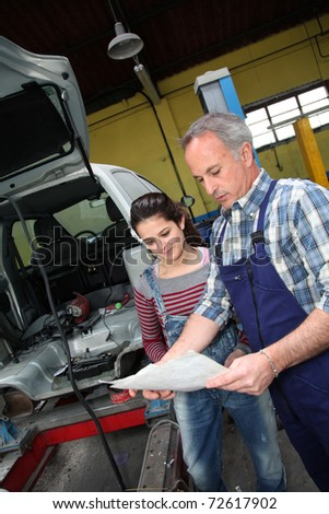 Portrait of professional and teenager in apprenticeship - stock photo