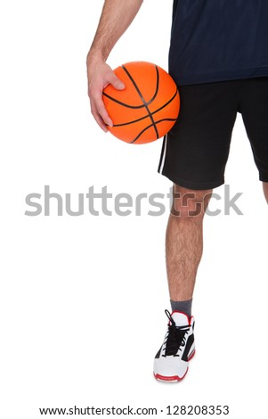 Portrait of professional basketball player. Isolated on white - stock photo
