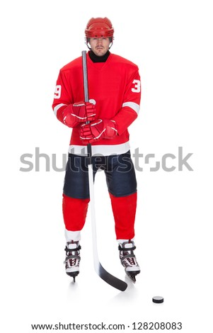 Portrait of professional hockey player. Isolated on white - stock photo