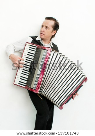 Portrait of professional musician with accordion - stock photo