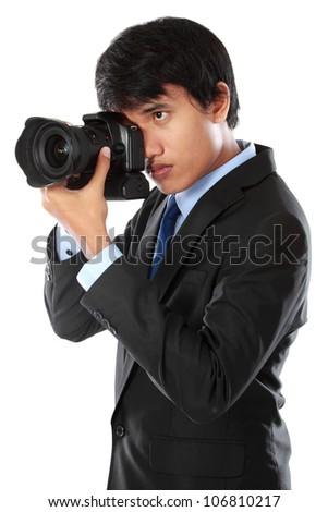 portrait of professional photographer ready to take photo using dslr camera - stock photo