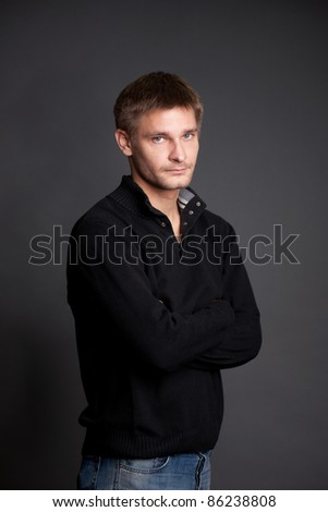 Portrait of real man posing for camera on grey background - stock photo