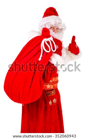 Portrait of Real Santa Claus carrying big bag from behind, isolated on white background - stock photo