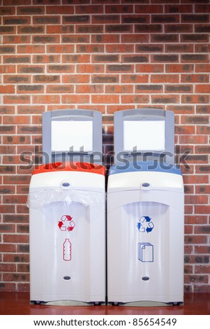 Portrait of recycling bins against a wall - stock photo