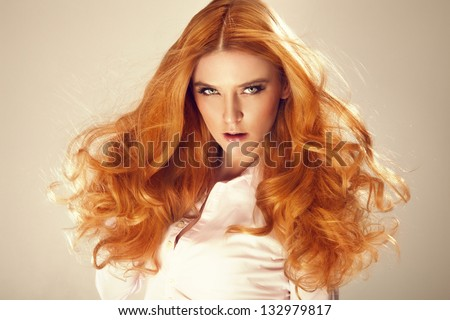 Portrait of red hair beautiful woman, looking at camera. - stock photo