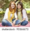 Portrait of redhead and brunette girls at outdoor. Autumn. - stock photo