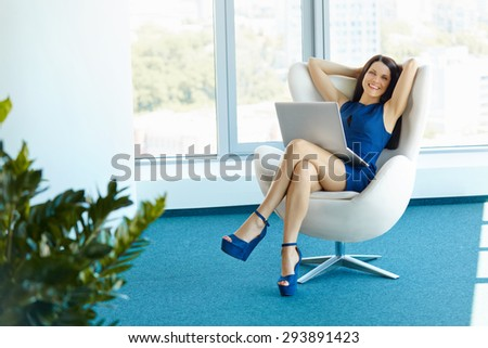 Portrait of relaxed business woman in office. Relax and freedom concept - stock photo