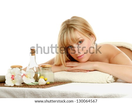 Portrait of relaxed young beautiful woman in spa environment - stock photo