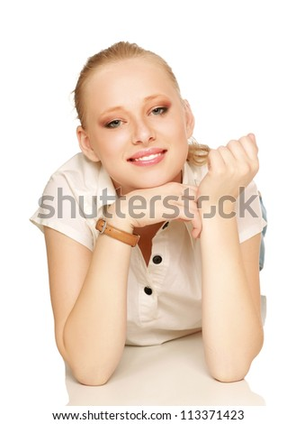 Portrait of relaxed young lady smiling while lying o floor - stock photo