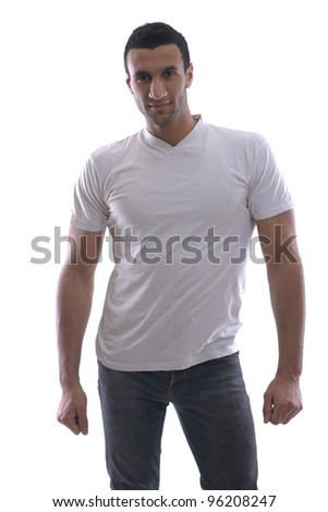 portrait of relaxed young man dressed in white shirt and jeans isolated over white background in studio - stock photo