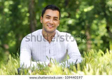 Portrait of relaxing man in  a summer day-SMALL DOF - stock photo
