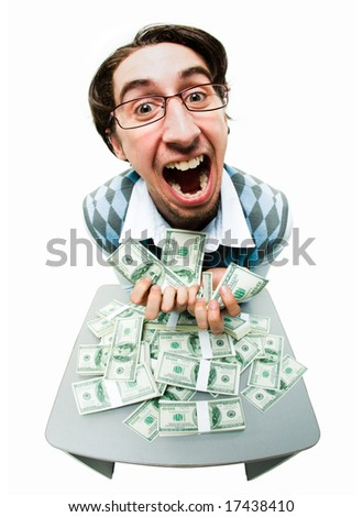 Portrait of rich man raking in American dollars with satisfied expression - stock photo