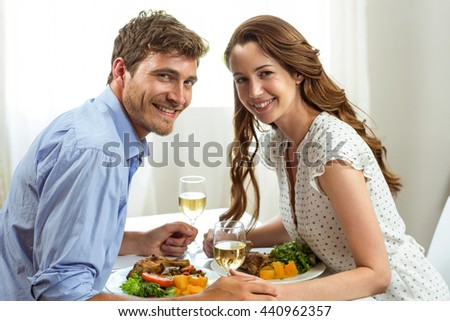 Portrait of romantic couple having lunch at home - stock photo