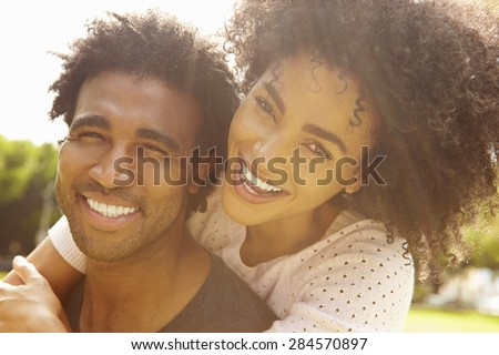 Portrait Of Romantic Couple Relaxing In Park - stock photo