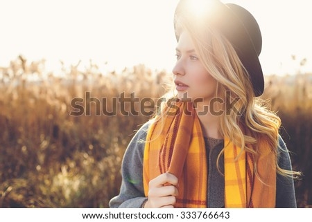 Portrait of romantic girl in a field in sunset light. winter, autumn life - stock photo
