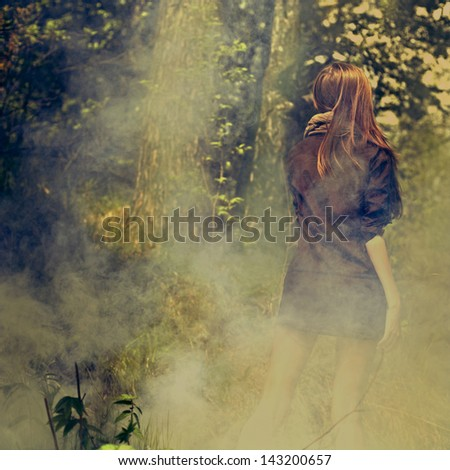 Portrait of romantic girl  in the magic woods - stock photo