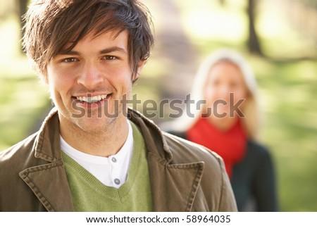 Portrait Of Romantic Young Couple In Autumn Park - stock photo