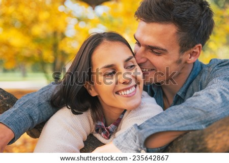 Portrait of romantic young couple outdoors in autumn - stock photo