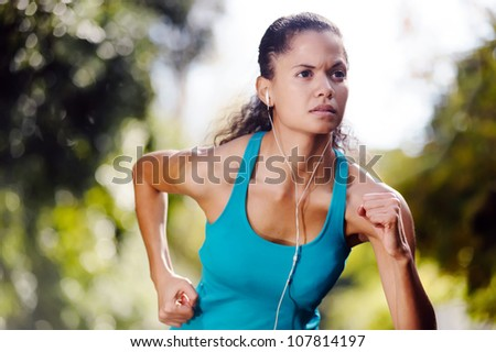 portrait of running healthy fitness woman training for marathon outdoors in alleyway. vitality lifestyle exercise athlete. - stock photo