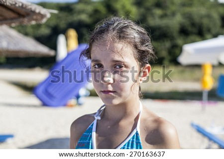 Portrait of sad child on the beach - stock photo