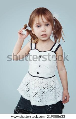 Portrait of sad little girl, studio shot - stock photo